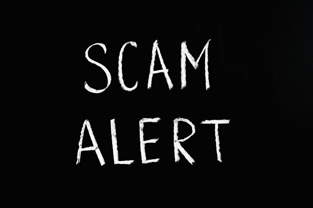 scam-alert-white-letters-black-background